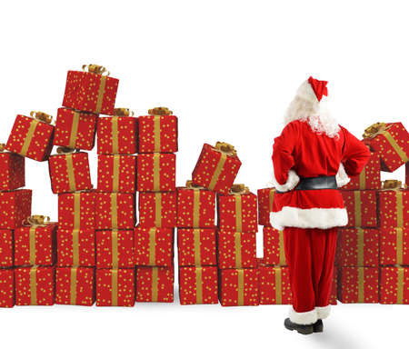 Santa Claus looks piles of Christmas gifts