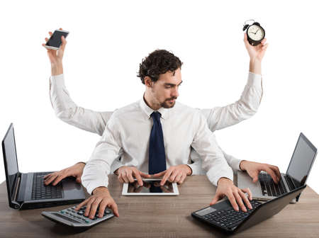 Businessman stressed by too many tasks works in the office Stock Photo