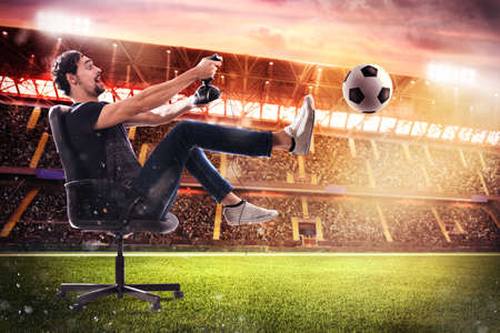 Boy with joystick plays with soccer video game