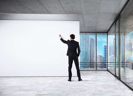 office presentation: Businessman making a presentation in his office Stock Photo