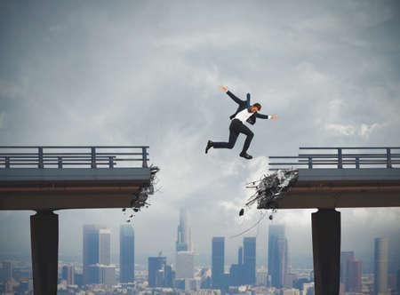 flit: Businessman passes a broken bridge with a big jump