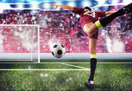 Soccer player towards the goal with the ball