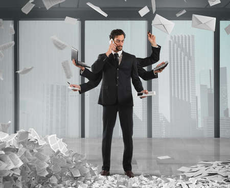 tired businessman: Businessman that to solve problems become multitasking with documents of bureaucracy and paperwork on background
