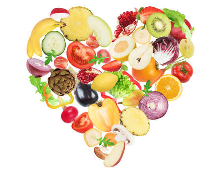 Vegetable and fruit forming a heart. Healthy food for wellness concept