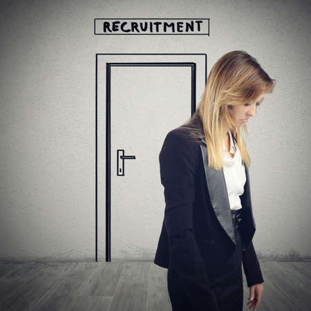 sorrowfully: Woman exits from the room of recruitment sorrowfully because she is not hired