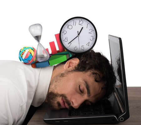 tiredness: Businessman exhausted from business crisis sleeping over computer