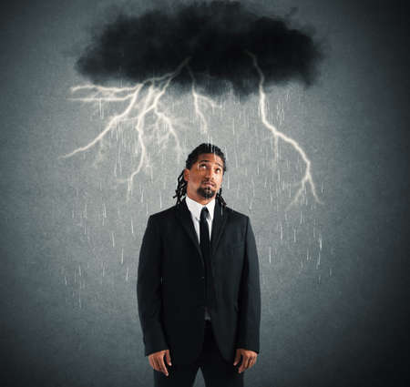 discouraged: Desperate businessman with cloud over his head