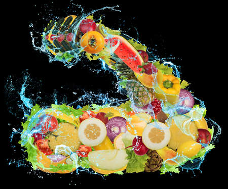 uncooked: Arm muscles formed from fruits and vegetables Stock Photo