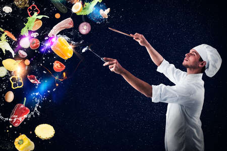creates: Chef creates a musical harmony with food and snow Stock Photo