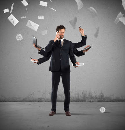 solve problems: Businessman that to solve problems become multitasking with sheets and letters on background
