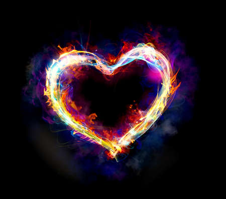 Heart with colourful light motion and fire on dark background Stock Photo