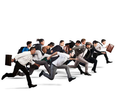 Business people run together in the same direction Фото со стока