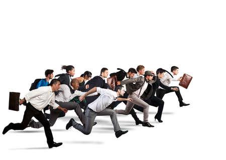 competencia: La gente de negocios corren juntos en la misma dirección Foto de archivo