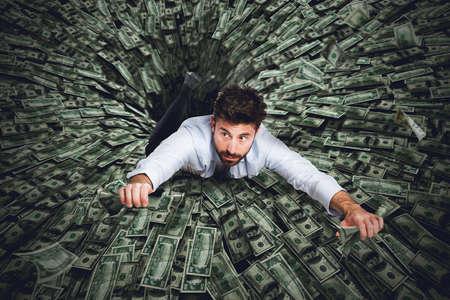 sucks: Big black hole that sucks much money and a businessman