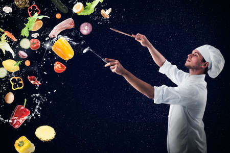 enchantment: Chef creates a musical harmony with food and snow Stock Photo