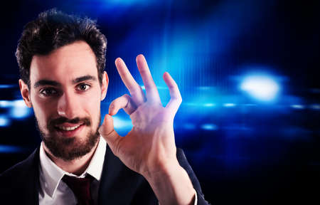 approved: Confident and positive businessman makes gesture ok