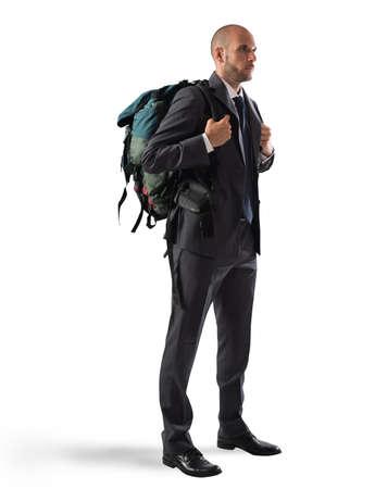 Businessman with elegant suit and explorer backpack