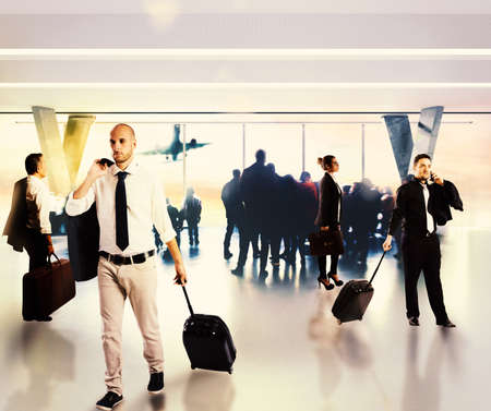 Busy businesspeople waiting at the airport for their flight photo