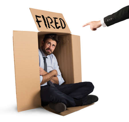 Desperate and fired businessman hides in the cardboard Stock Photo