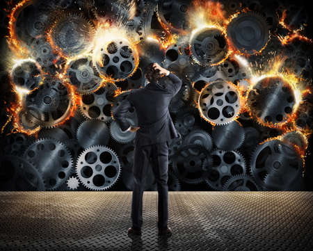 explosives: Stress concept with overworked businessman desperately looks a gear mechanism burn