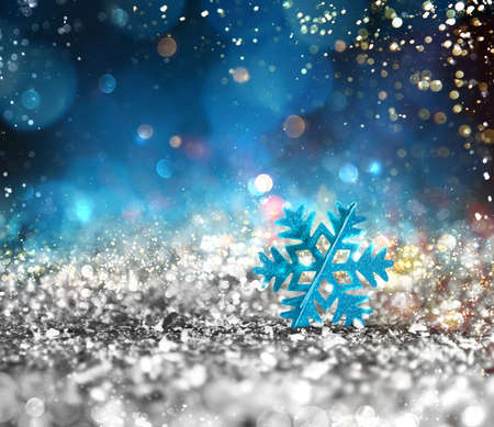 Background of Xmas decoration with sparkly silver crystal with shiny blue snowflake