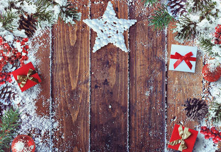 silver: Xmas grunge decoration on wood background with sparkling star presents and snow
