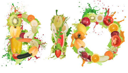 Fruit and vegetables forming the word bio with splashes of color. Healthy Bio food for wellness concept Stock Photo