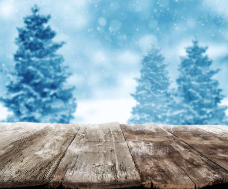 Background of Xmas scenery with wooden planks and snowy landscape