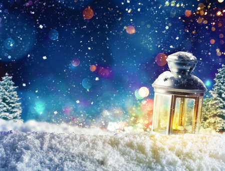 Xmas decoration background with lantern on snow