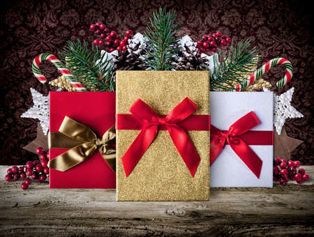 box: Xmas grunge decoration background with presents candy stars and pine cone on wooden boards