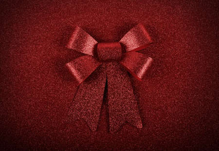 decorate: Glittering red ribbon with bow for xmas on sparkly background Stock Photo