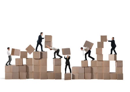 problem: Team of businesspeople build a construction with wood cubes