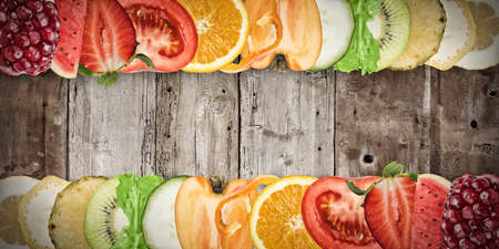 Colourful fruit banner on wood background. Healthy food concept