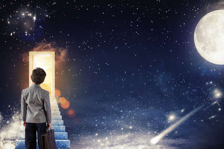 Boy climbs the stairs to a door with sunlight on a starry sky with the moon and the stars photo