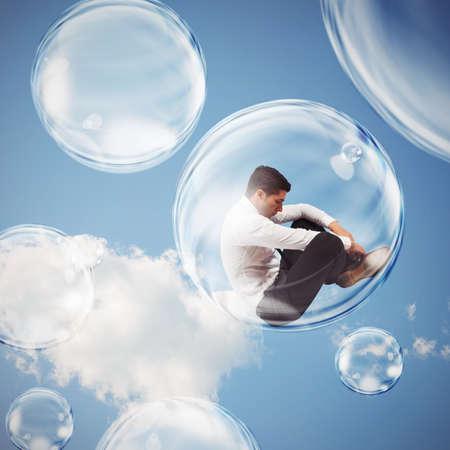 Droevige zakenman vliegt in een luchtbel. isoleren zich binnen een bel onthechting van de buitenwereld-concept