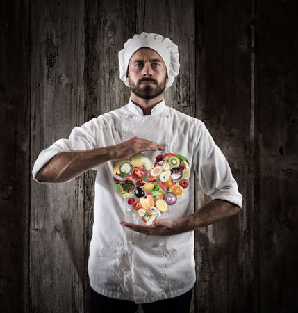 fruit: Chef specialized in vegetarian with fresh vegetables. Healthy food for wellness concept Stock Photo