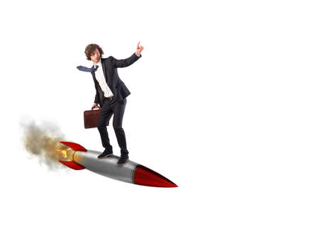 Businessman flying over a rocket. Increase the climb to success concept Stock Photo