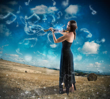 violinist: Charming violinist countryside Stock Photo