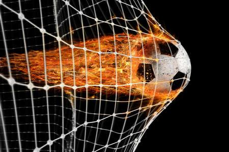 サッカー火の玉は得点ネット上 写真素材