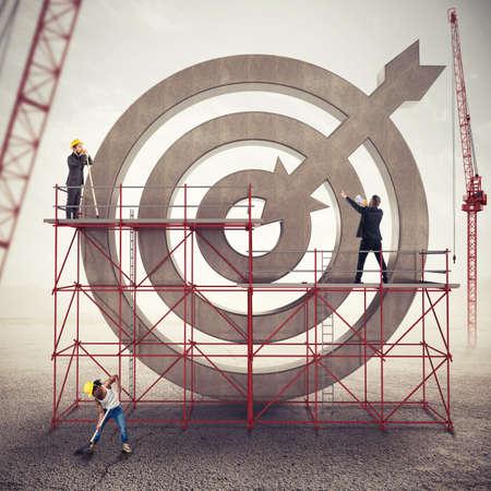 Teamwork build a business target . Mixed media