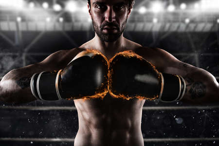 Confident boxer with fiery boxing gloves Stock Photo - 71563216