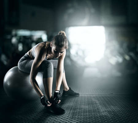 Workout with fitness ball Stock Photo - 71737605