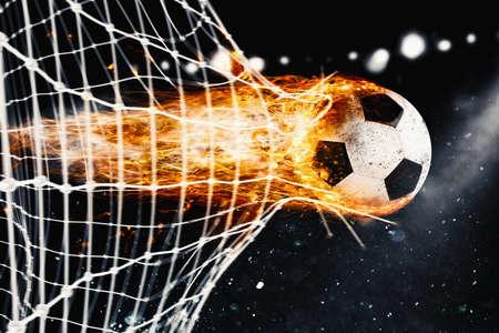 Calcio palla di fuoco segna un gol in rete Archivio Fotografico - 71737607
