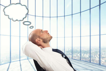Successful Businessman relax and think Stock Photo