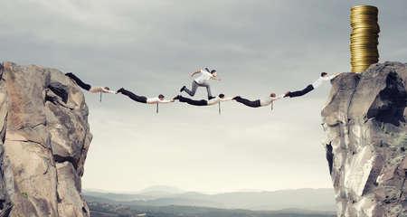 earn money: Businessmen support bridge to get the money Stock Photo