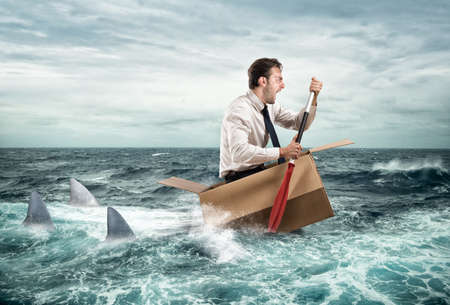 worried businessman: Escape from crisis Stock Photo