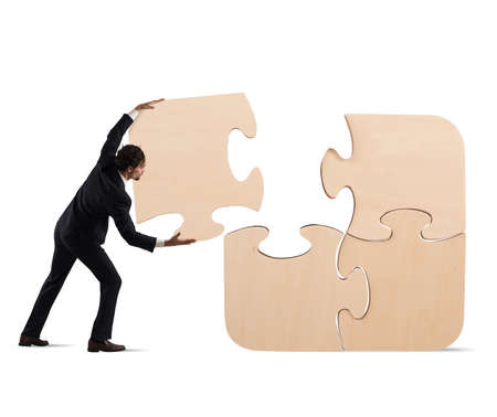 Complete a puzzle with missing piece Stock Photo