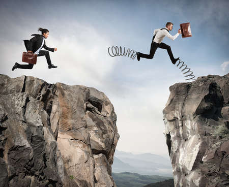 overcoming adversity: Irregular competition with obstacle Stock Photo