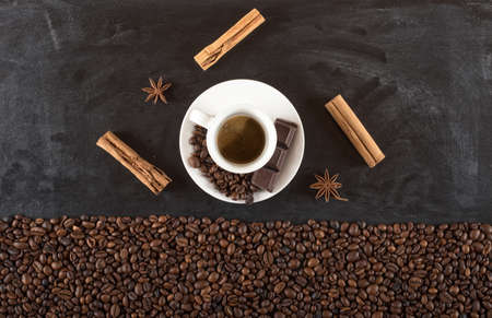 dark: Background of cup coffee beans with cinnamon and anise Stock Photo