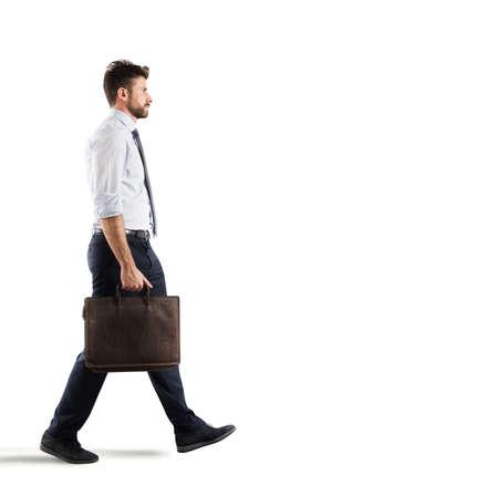 Businessman walks on white background
